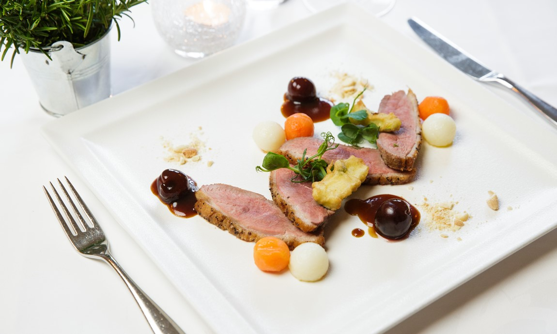 Duck breast, crispy courgettes, honey glazed baby carrots, Parisienne potatoes, black cherries, crushed almonds