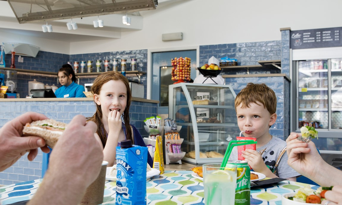 Kids enjoying the Cascades Café Bar